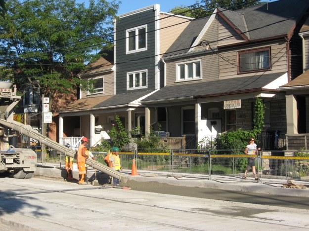 Pouring concrete on Queen East across from the Ashbridge Estate