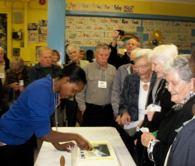 2012  Oct. 21  Maureen Allen-Doorley cuts Duke's 100th anniversary cake for alumni and friends